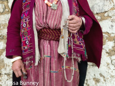 A Brokpa woman wearing her traditional clothing holds Buddhist rosary beads outside the temple on an 'auspicious day' in the remote village of Merak in Eastern Bhutan. The Brokpa, the semi-nomads of the villages of Merak and Sakteng are said to have migrated to Bhutan a few centuries ago from the Tshona region of Southern Tibet. Thriving on rearing yaks and sheep, the Brokpas have maintained many of their unique traditions and customs.